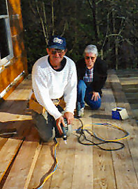 Bill and Vicky Take a Break on the Future Porch of the Cabin in the Orchard